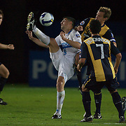Pohang Steelers forward Ristik Stevica over head kicks while challenged by John Hutchinson (7)  and Alex Wilkinson during the group H group stage match between the Central Coast Mariners of Australia and Pohang Steelers of Korea in Gosford, Australia on March 11 2009, The match ended in a 0-0 draw. Photo Tim Clayton