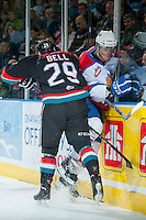 KELOWNA, CANADA - NOVEMBER 9: Myles Bell #29 of the Kelowna Rockets checks a player of the Edmonton OIl Kings into the boards on November 9, 2013 at Prospera Place in Kelowna, British Columbia, Canada.   (Photo by Marissa Baecker/Shoot the Breeze)  ***  Local Caption  ***