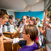 August 21, 2016, New Haven, Connecticut: <br /> Agnieszka Radwanska of Poland signs autographs during a Box Holder meet and greet during WTA All-Access Hour on Day 3 of the 2016 Connecticut Open at the Yale University Tennis Center on Sunday, August  21, 2016 in New Haven, Connecticut. <br /> (Photo by Billie Weiss/Connecticut Open)