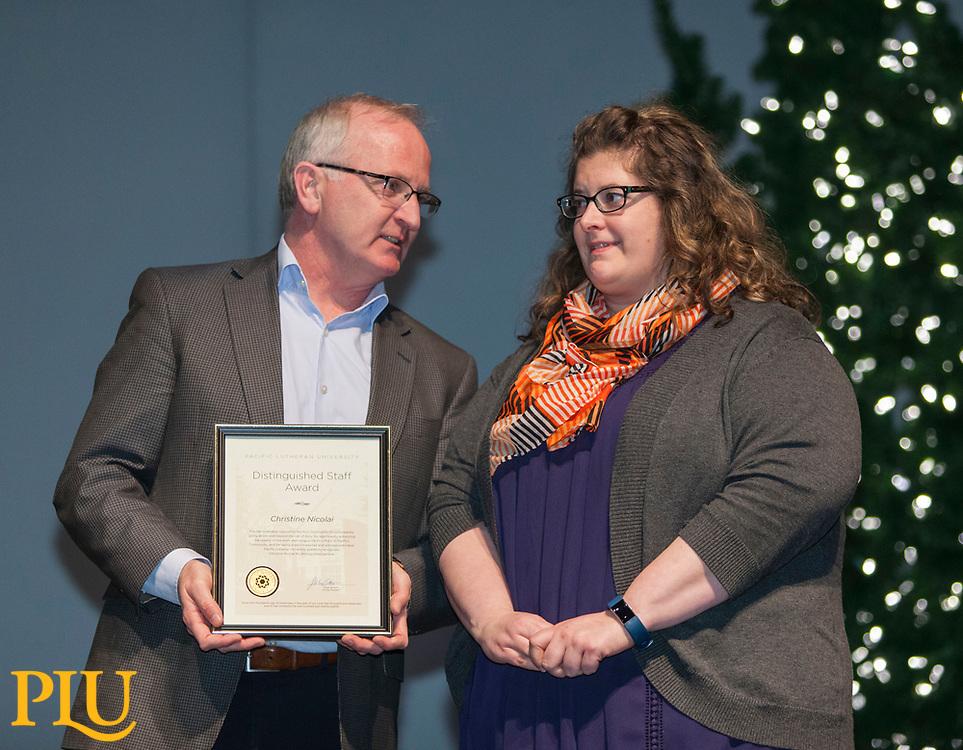 Allan Belton present an award to Christine Nicolai at the PLU Christmas Brunch, Thursday, Dec. 14, 2017. (Photo: John Froschauer/PLU)