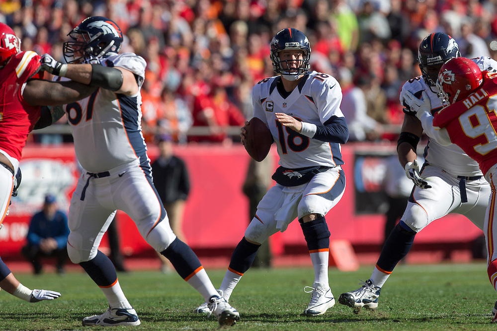 KANSAS CITY, MO - NOVEMBER 25: Peyton Manning #18 of the Denver Broncos drops back to pass against the Kansas City Chiefs at Arrowhead Stadium on November 25, 2012 in Kansas City, Missouri.  The Broncos defeated the Chiefs 17-9. (Photo by Wesley Hitt/Getty Images) *** Local Caption *** Peyton Manning