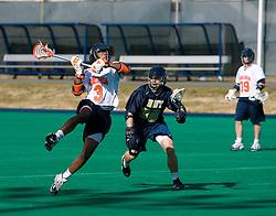Virginia midfielder Rhamel Bratton (3) shoots against Navy.  The Virginia Cavaliers scrimmaged the Navy Midshipmen in lacrosse at the University Hall Turf Field  in Charlottesville, VA on February 2, 2008.