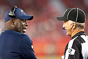 Los Angeles Chargers head coach Anthony Lynn has a laugh with an official on the sideline during the 2018 NFL preseason week 4 football game against the San Francisco 49ers on Thursday, Aug. 30, 2018 in Santa Clara, Calif. The Chargers won the game 23-21. (©Paul Anthony Spinelli)
