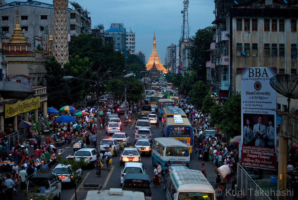 (November 15, 2012 Yangon, Myanmar).Cars and people fill street in downtown Yangon as Sule Pagoda is seen in the back ground in Myanmar on Nov 15, 2012. As import restrictions were loosened this year, number of cars, mostly from Japan, have increased drastically. .(Photo by Kuni Takahashi).