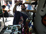 Beard trim for 10 RMB in Dali,Yunnan province, China; September, 2013.