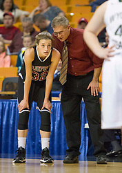 Bluefield head coach Tony Mallamaci talks with Bluefield center Dani Janutolo (32) during a foul shot against Wyoming East during a first round game at the Charleston Civic Center.