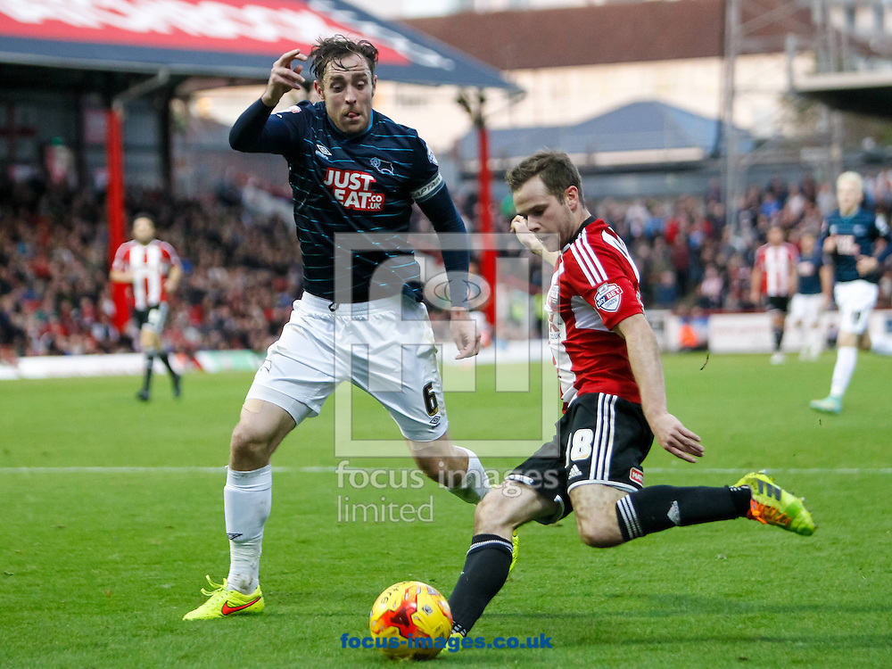 Richard Keogh of Derby County and Alan Judge of Brentford during the Sky Bet Championship match between Brentford and Derby County at Griffin Park, London<br /> Picture by Mark D Fuller/Focus Images Ltd +44 7774 216216<br /> 01/11/2014