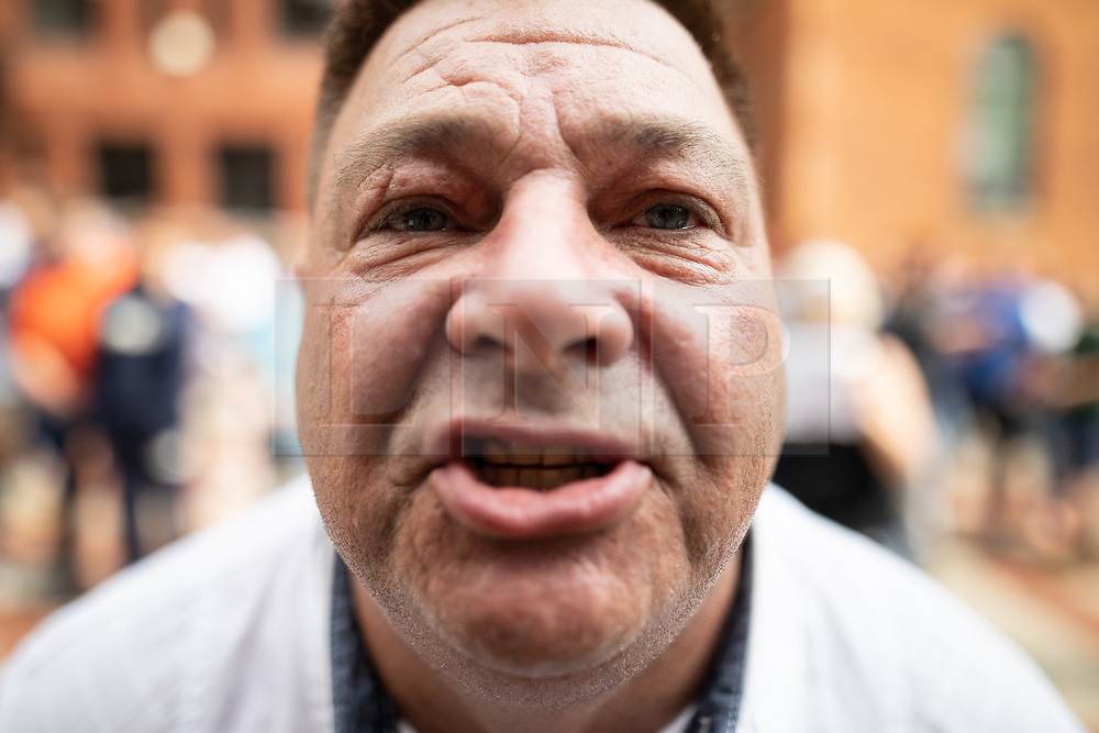 © Licensed to London News Pictures. 01/06/2018. Leeds, UK. A man shouts out in support of Tommy Robinson outside Leeds Crown Court . Supporters of EDL founder Tommy Robinson ( real name Stephen Yaxley-Lennon ) demonstrate in Leeds after Robinson was convicted of Contempt of Court . Robinson was already serving a suspended sentence for Contempt of Court over a similar incident , when he was convicted on Friday 25th May 2018 . Reporting restrictions , since lifted , initially prevented coverage of Robinson's arrest and incarceration . Photo credit: Joel Goodman/LNP