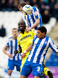 COLCHESTER, ENGLAND - Saturday, February 23, 2013: Tranmere Rovers' Mamady Sidibe in action against Colchester United's Bradley Garmston during the Football League One match at the Colchester Community Stadium. (Pic by Vegard Grott/Propaganda)