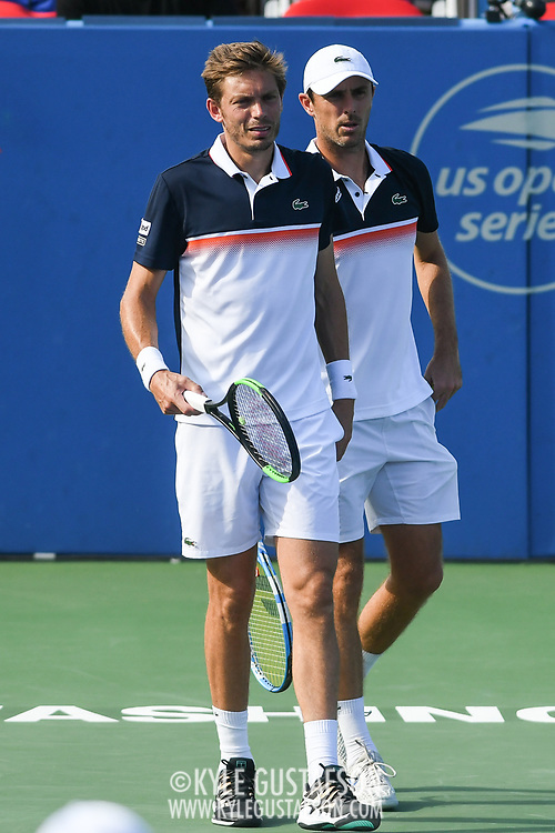 NICHOLAS MAHUT and EDOUARD ROGER-VASSELIN talk between points at the Rock Creek Tennis Center.