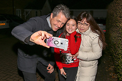© Licensed to London News Pictures. 01/12/2019. London, UK. Actor and film producer HUGH GRANT takes a selfie with Liberal Democrat supporters as he joins Liberal Democrats' parliamentary candidate for Finchley & Golders Green, LUCIANA BERGER during canvassing in Finchley, North London, to bid to stop a Conservative majority and Stop Brexit. Photo credit: Dinendra Haria/LNP