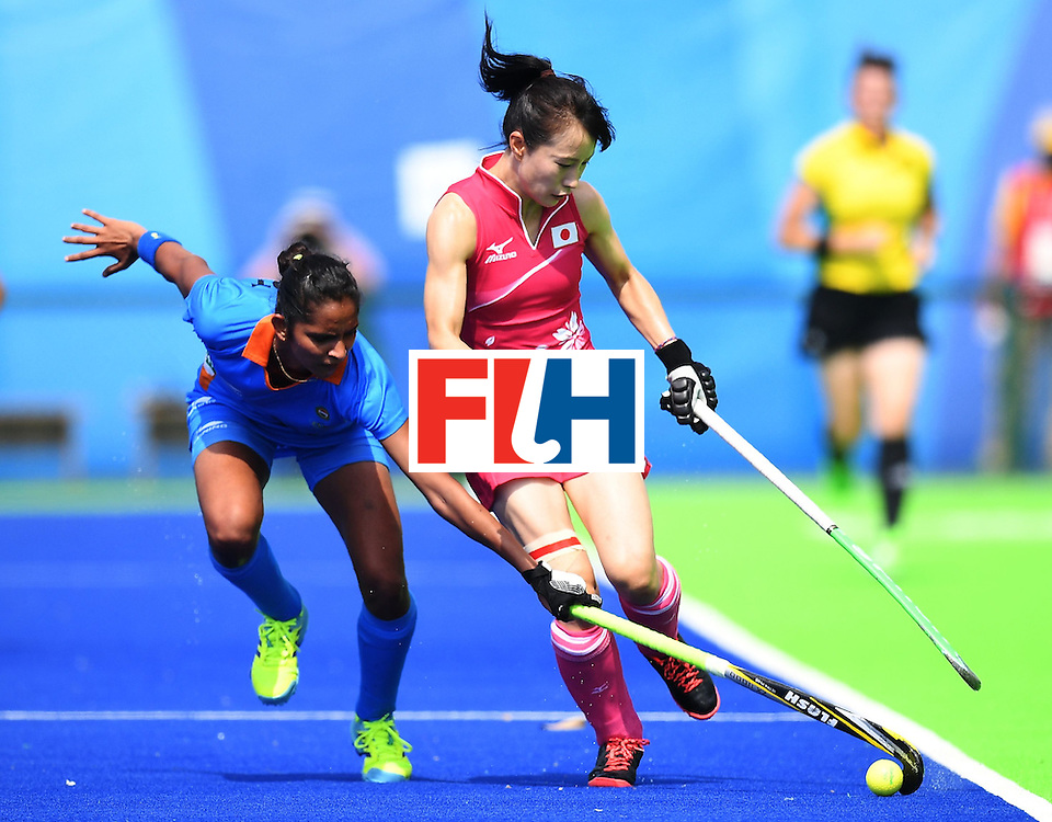 India's Navjot Kaur (L) vies for the ball with Japan's Mie Nakashima during the women's field hockey Japan vs India match of the Rio 2016 Olympics Games at the Olympic Hockey Centre in Rio de Janeiro on August, 7 2016. / AFP / MANAN VATSYAYANA        (Photo credit should read MANAN VATSYAYANA/AFP/Getty Images)