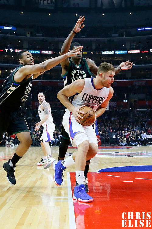 16 December 2015: Los Angeles Clippers forward Blake Griffin (32) drives past Milwaukee Bucks guard O.J. Mayo (3) and Milwaukee Bucks forward Jabari Parker (12) during the Los Angeles Clippers 103-90 victory over the Milwaukee Bucks, at the Staples Center, Los Angeles, California, USA.