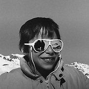 Portrait of a boy wearing reflecting sun glasses.<br /> <br /> (Analog black and white image. Scan from manually developed negative.)