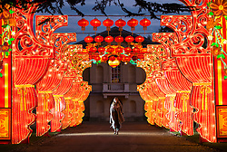 © Licensed to London News Pictures. 18/01/2017. London, UK. A woman walks along a walkway of Chinese lanterns, with Chiswick House in the background, at the Chiswick House Magic Lantern Festival. The Festival is a fusion of art, heritage and culture. Illuminating outdoor installations of beautifully sculpted lanterns taking various forms. Opening tomorrow and running until February 26th 2017 the theme for this year's festival is: 'Explore The Silk Road'. Visitors will discover life-sized and oversized lantern scenes, which represent and highlight this significant route of trade and culture from Europe to Ancient China.Photo credit: Peter Macdiarmid/LNP