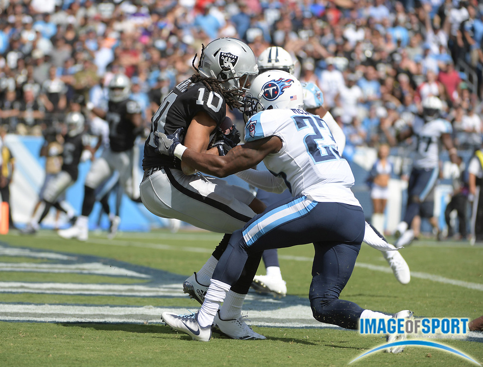 Sep 10, 2017; Nashville, TN, USA; Oakland Raiders wide receiver Seth Roberts (10) is defended by Tennessee Titans cornerback Brice McCain (23) on a 19-yard touchdown reception in the fourth quarter during a NFL football game at Nissan Stadium. The Raiders defeated the Titans 26-16.