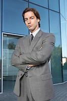 Business man standing outside office building portrait