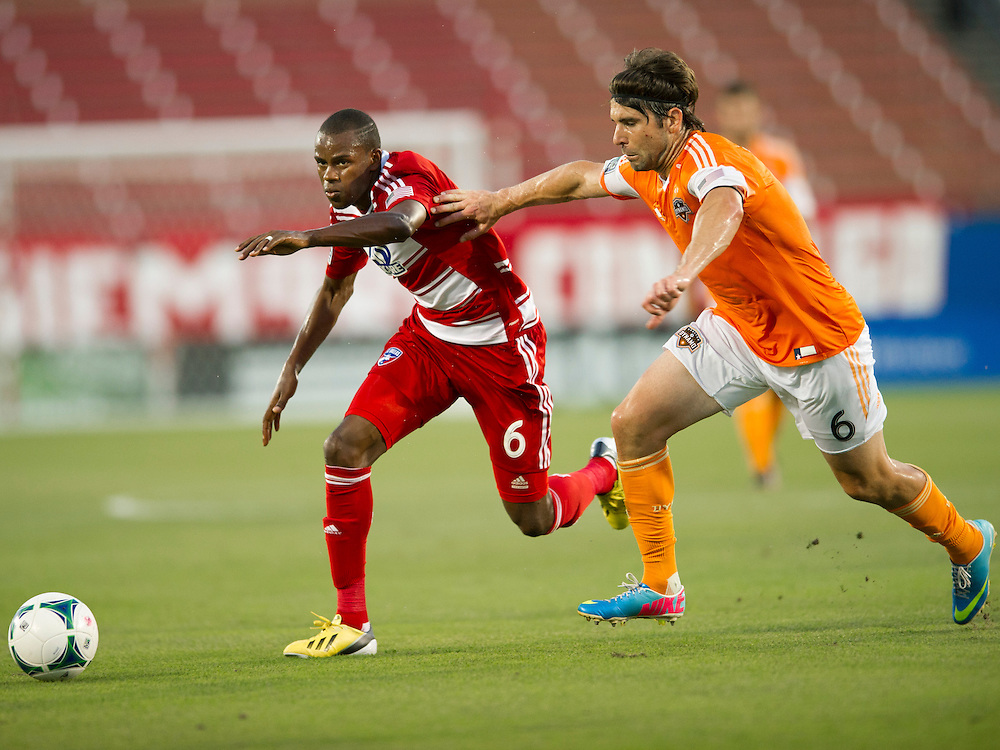 FRISCO, TX - JUNE 12:  Jackson #6 of FC Dallas battles for the ball with Mike Chabala #6 of Houston Dynamo on June 12, 2013 at FC Dallas Stadium in Frisco, Texas.  (Photo by Cooper Neill/Getty Images) *** Local Caption *** Jackson; Mike Chabala