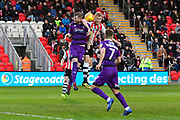 Alex Whitmore (25) of Grimsby Town clashes with Jayden Stockley (11) of Exeter City during the EFL Sky Bet League 2 match between Exeter City and Grimsby Town FC at St James' Park, Exeter, England on 29 December 2018.