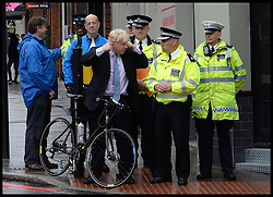 The Mayor Boris Johnson joins police by Tower Bridge, London, as road safety enforcement is stepped up. The Mayor of London join's officers from the Metropolitan Police for a road safety operation. Operation Safeway was launched late last year in response to a series of tragic cyclist and pedestrian deaths on London's roads. 27th May 2014. Picture by Andrew Parsons / i-Images
