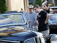 Harold Perrong (left) and Andrew Perrong of Huntingdon Valley, Pennsylvania view a 1939 Dodge during the 6th Annual Doylestown at Dusk Car Show Saturday July 18, 2015 in Doylestown, Pennsylvania. (Photo by William Thomas Cain)