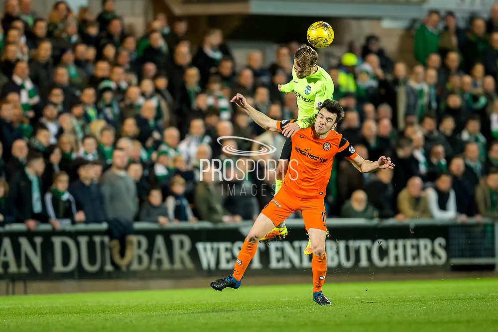 Hibernian midfielder Andrew Shinnie (#22) wins the header against Dundee United midfielder Scott Fraser (#10) during the Ladbrokes Scottish Championship match between Dundee United and Hibernian at Tannadice Park, Dundee, Scotland on 10 March 2017. Photo by Craig Doyle.