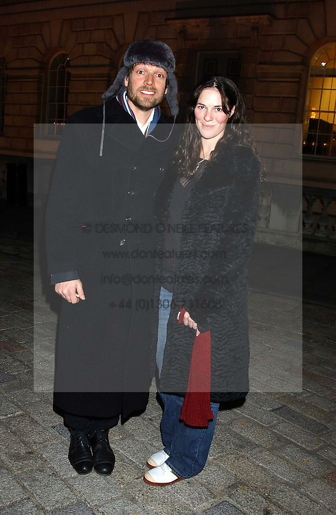 Musician ALEX JAMES and CLAIRE NEATE at a party to celebrate the opening of the annual Somerset House Ice Rink at Somerset House, London on 23rd November 2005.<br />