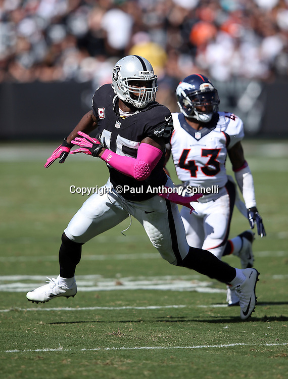 Oakland Raiders fullback Marcel Reece (45) goes out for a second quarter pass while covered by Denver Broncos strong safety T.J. Ward (43) during the 2015 NFL week 5 regular season football game against the Denver Broncos on Sunday, Oct. 11, 2015 in Oakland, Calif. The Broncos won the game 16-10. (©Paul Anthony Spinelli)