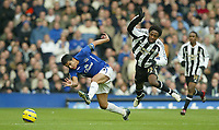 Photo: Aidan Ellis.<br /> Everton v Newcastle. The Barclays Premiership.<br /> 27/11/2005.<br /> Everton's Tim Cahill and Newcastle's Celestine Babayaro tangle again