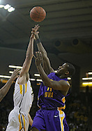 December 07 2010: Northern Iowa Panthers guard Kwadzo Ahelegbe (11) tries to get a shot over Iowa Hawkeyes guard Eric May (25) during the first half of their NCAA basketball game at Carver-Hawkeye Arena in Iowa City, Iowa on December 7, 2010. Iowa defeated Northern Iowa 51-39.