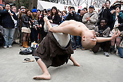 """A man dressed in a Buddhist monks robes performs a fertility dance during the Kanamara Festival in Kawasaki, Japan on 04 April 2010. The fertility festival, often just called the """"penis festival,"""" has been held since the early 1600s and also aims to promote awareness of AIDS and STDs. ."""