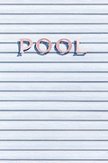 the word pool written on a white wooden wall