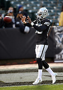 Oakland Raiders wide receiver James Jones (89) catches a pass while warming up before the NFL week 12 regular season football game against the Kansas City Chiefs on Thursday, Nov. 20, 2014 in Oakland, Calif. The Raiders won their first game of the season 24-20. ©Paul Anthony Spinelli