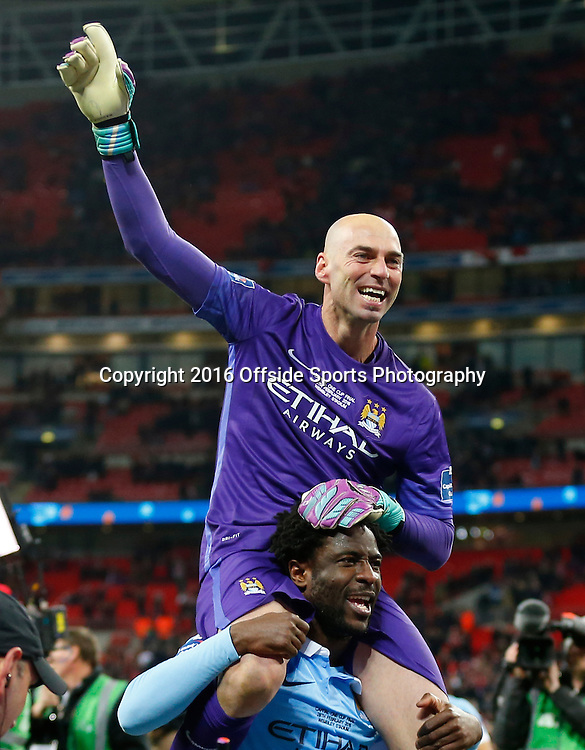28 February 2016 - The Capital One Cup Final - Liverpool v Manchester City - Wilfredo Caballero of Manchester City celebrates on the shoulders of Wilfried Bony - Photo: Marc Atkins / Offside.