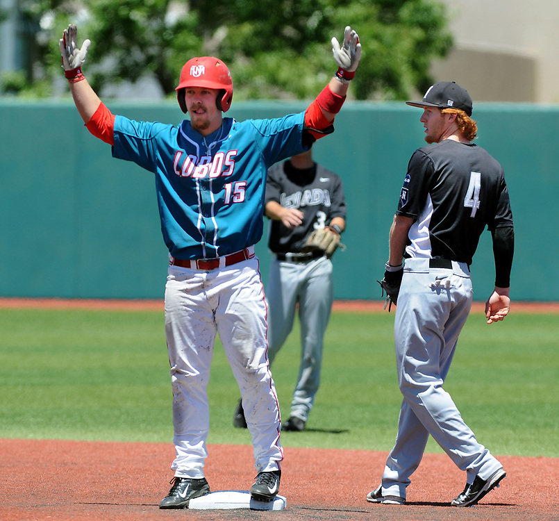 jt052017h/ sports/jim thompson/UNM's #15 Jared Mang signals his teammates in the dugout after his double in the   Saturday May. 20, 2017. (Jim Thompson/Albuquerque Journal)