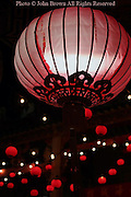 Colorful Chinese lanterns are lighted at night while hanging at a Buddhist temple in Georgetown, Penang, Malaysia.