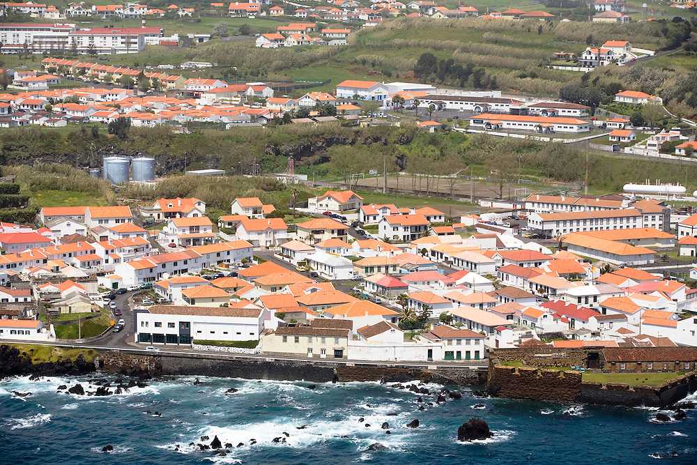 A view of the edges of the town of Horta and its typical white buildings, a color mandated by the town council. .Horta is on the Portuguese island of Faial, one of the Azores, which mark the most western boundaries of the E.U.