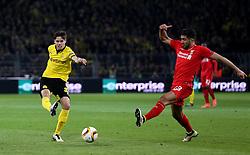 Julian Weigl of Borussia Dortmund shoots past Emre Can of Liverpool - Mandatory by-line: Robbie Stephenson/JMP - 07/04/2016 - FOOTBALL - Signal Iduna Park - Dortmund,  - Borussia Dortmund v Liverpool - UEFA Europa League Quarter Finals First Leg