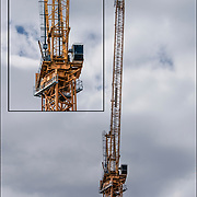 Tower Crane on top of skyscraper under construction.