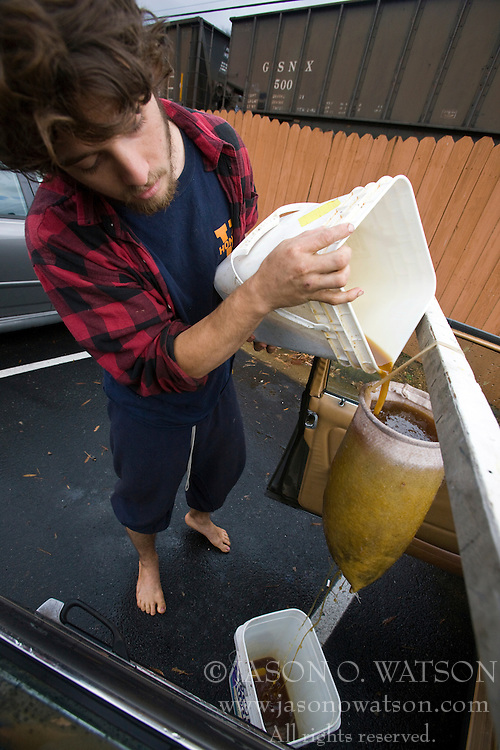 November 15, 2008; Charlottesville, VA, USA; Fourth-year University of Virginia student Stephen Bradford converted his Mercedes Benz station wagon to run off of filtered vegetable oil to save on gas costs.  Bradford, who uses spent vegetable oil from local restaurants, runs the oil through a filtration process before filling up a special 15 gallon tank in the trunk of his car.