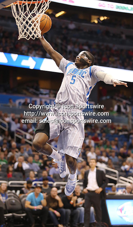 Dec. 23, 2014 - Orlando, FL, USA - The Orlando Magic's Victor Oladipo scores against the Boston Celtics at the Amway Center in Orlando, Fla., on Tuesday, Dec. 23, 2014