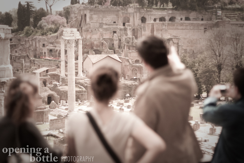 A tour guide points to the Basilica Julia and Temple of the Castori inside the Roman Forum from Palantine Hill, Rome, Lazio, Italy. Full color image available upon request.