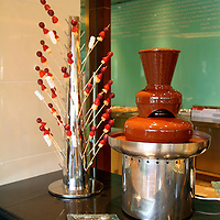 Asia, China, Beijing. Chocolate Fountain and fruit sticks at the Shangri-La Beijing buffet lunch.
