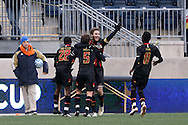 15 December 2013: Maryland's Patrick Mullins (center) celebrates his first half goal with Chris Odoi-Atsem (28), Mikey Ambrose (5) and Mikias Eticha (11). The University of Maryland Terripans played the University of Notre Dame Fighting Irish at PPL Park in Chester, Pennsylvania in a 2013 NCAA Division I Men's College Cup championship match.