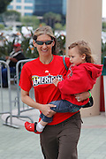 ANAHEIM, CA - MAY 08:  A mother and her young daughter work their way to the main entrance for the Mother's Day game between the Cleveland Indians and the Los Angeles Angels of Anaheim on Sunday, May 8, 2011 at Angel Stadium in Anaheim, California. The Angels won the game 6-5. (Photo by Paul Spinelli/MLB Photos via Getty Images)