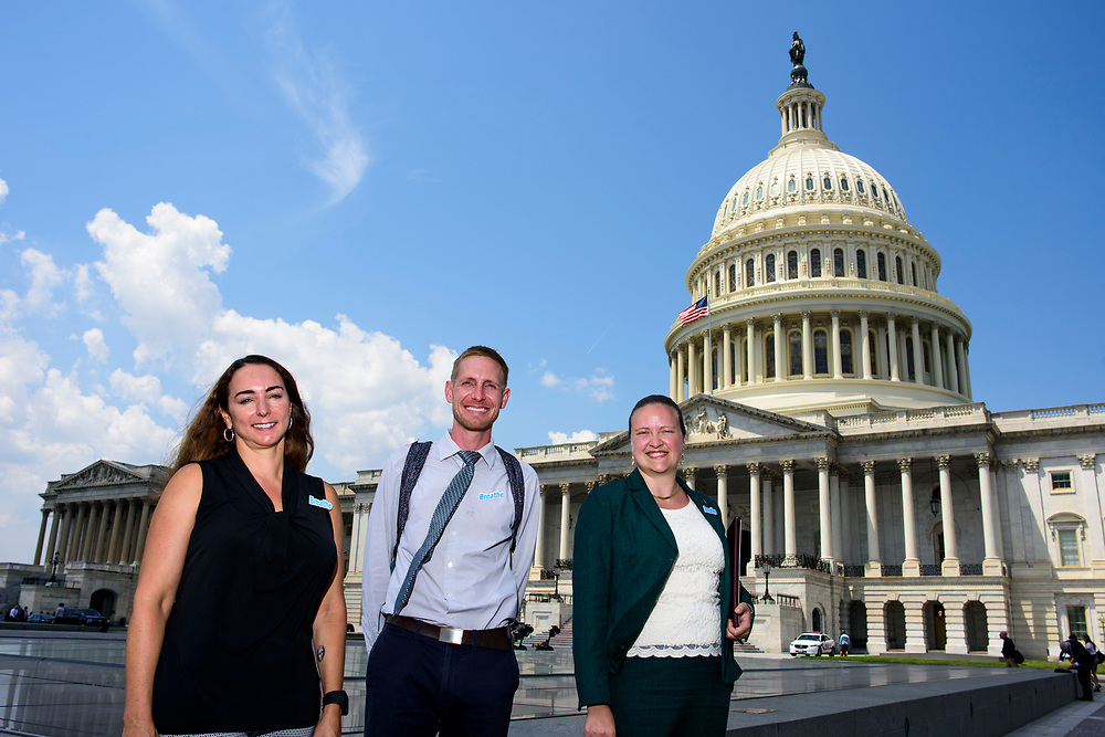 Washington, D.C. - June 13, 2017: Members of Earthjustice stand in front of the U.S. Capitol (L-R) Jessica Hodge, Advocacy Communications Manager for the D.C. office, Lead Lobbyist Terry McGuire, and Julia Muench Rumburg, summer league intern with Earthjustice. Earthjustice hosted a Clean Air Fly-In to the congressional office buildings in Washington D.C. Tuesday June 13, 2017.<br /> <br /> <br /> CREDIT: Matt Roth for Earthjustice