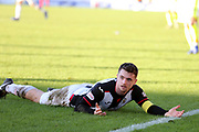 St Mirren midfielder Stephen McGinn (4) goes to ground and appeals for a foul during the Ladbrokes Scottish Premiership match between St Mirren and Hibernian at the Paisley 2021 Stadium, St Mirren, Scotland on 27 January 2019.
