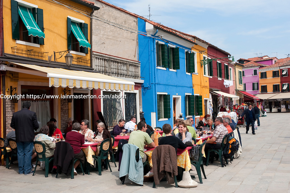 Colourful houses and restaurant in village of Burano near Venice in Italy