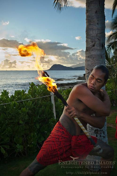 Flame juggling hula dancer holding torch, Paradise Cove Luau, Kapolei, Oahu, Hawaii