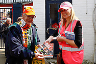A Luton Town fan buys an official matchday programme, 'Talk of the Town', from a programme seller ahead of the Skrill Conference Premier match at Kenilworth Road, Luton<br /> Picture by David Horn/Focus Images Ltd +44 7545 970036<br /> 21/04/2014